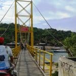 Cycling over the bridge to Ceningan.
